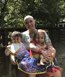 Brie Lee, a Mars High School alum, poses for a photo with her children Laila, 10 months, and Ava, 2.