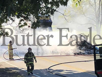Photos by J.W. Johnson Jr.Firefighters work to extinguish garbage that caught fire in a truck on Unionville Road on Thursday.