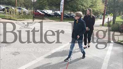 National White Cane Day is October 15 and is used to celebrate the independence blind people gained in being able to travel alone. Left to right: Jessica Sloan, orientation and mobility specialist; Brandon Wingard, legally blind eighth grade student at Ryan Gloyer Middle School; RGMS secretary; Robin Wingard, Brandon's mother.