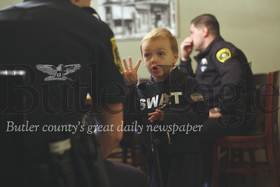 Maddox VanDeusen, decked out in his Halloween SWAT uniform, shows officer his radio, handcuffs and night stick. photos by Caleb Harshberger
