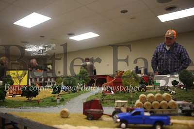 These are intricate student-made replicas of farms, often family farms, that feature all manner of tiny tractors, structures and animals surrounded by often handmade landscaping and topography. Carl Condra'd's replica is pictured here.These are intricate student-made replicas of farms, often family farms, that feature all manner of tiny tractors, structures and animals surrounded by often handmade landscaping and topography. Carl Condra'd's replica is pictured here.These are intricate student-made replicas of farms, often family farms, that feature all manner of tiny tractors, structures and animals surrounded by often handmade landscaping and topography. Carl Condra'd's replica is pictured here. Photos by Caleb Harshberger