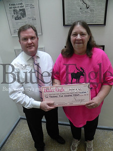 Keith Graham, Butler Eagle vice president of advertising, presents Cheryl Schaefer, Butler Breast Cancer and Women's Cancer Support Group coordinator, a donation of $2,500 raised from proceeds from the PINK editions of the Butler Eagle Oct. 2 and Cranberry Eagle Oct. 3. The effort is part of Breast Cancer Awareness Month. Lynn Schraf/Butler Eagle