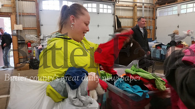 The other is Autumn Havrilesko of Butler looking through the bins of free children's clothing available at the event.