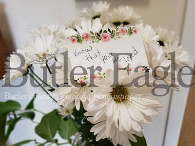 An anonymous member of Grace at Calvary Lutheran Church sent flowers to Butler's B'nai Abraham synagogue Sunday. The custodian who found the flowers said he wept upon seeing them. Tanner Cole/Butler Eagle