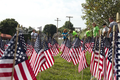 Members of AJ 22 Too Many plant flags in St. Peter's Reformed Church in Zelienople on Aug. 31, 2018