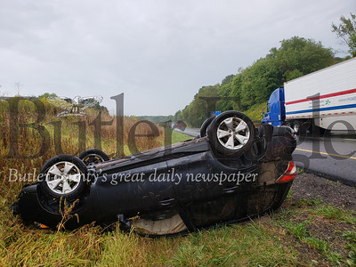 A pregnant woman flipped her vehicle Thursday at about 11 a.m. while traveling north on I-79 in Muddycreek Township.