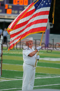Engineer 2nd Class Ron Muff (USN '63-'67) pesents the colors for the Honring Our Veterans portion of the pre-game show at Karns City Stadium on Friday September 7, 2018. (Jason Swanson photo)