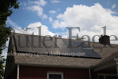 Solar panels absorb solar energy and are converted from AC current to DC current in order to power the house. If the home does not use all the energy produced, the excess goes back into the power grid. (photo by caleb harshberger)