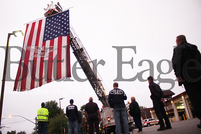"Members of the Cranberry Fire Department gathered at the fire station early Tuesday morning to raise a flag in remembrance of the events of 9/11 and those whose lives were lost.The 20 by 30-foot flag was raised at sunrise and motorists on Route 19 will see the flag throughout the day.""It's important that nobody forgets,"" said David Gallagher, Chief of Fire and Emergency Services."
