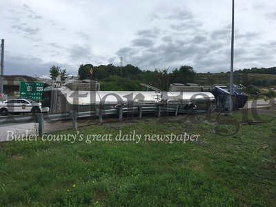 State police investigate the rollover crash Wednesday morning of a water tanker truck on Route 68 at the Route 422 east on-ramp in Summit Township.