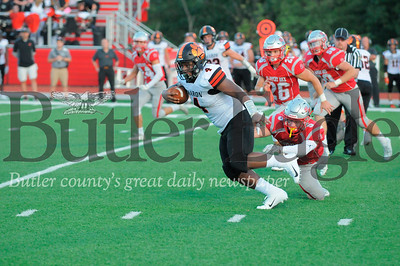 Sharon #4 Jordan Wilson rushes past Slippery Rock #5 Kaleb Kamerer during a game at Rocket Stadium on Friday September 14, 2018. (Jason Swanson photo)
