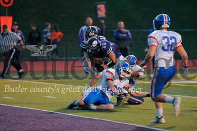 Karns City #18 Hunter Jones is tackled by St. Mary #34 Austin Pritt and #62 Bryce Schatz during a game at Karns City Stdium on Friday September 28, 2018 (Jason Swanson photo)