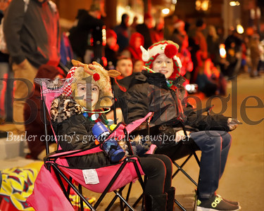 Crowds of Butler area residents claim their spot prior to the start of Butler's Spirit of Christmas Parade Saturday. Seb Foltz/Butler Eagle