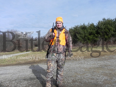 Logan Bergbigler of Fenelton takes a break from hunting Saturday morning at the State Game Lands No. 34.