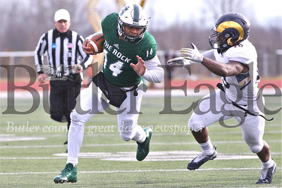 Slippery Rock quarterback Roland Rivvers III rolls out on a quarterback keeper bootleg in Saturday's home playoff game against Shepherd University. SRU topped Shepherd 51-30. Seb Foltz/Butler Eagle