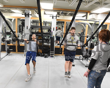Harold Aughton/Butler Eagle: Justin D' Antonio (left) and Josh Denny work out on the new Queenex Rig work out station at the Butler YMCA, Friday, Nov. 29, 2019.