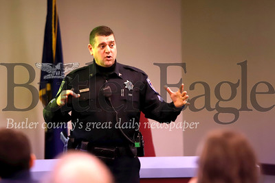Cranberry police corporal  William Och leads an active shooter workshop with Cranberry Township employees Wednesday at the Cranberry Township Municipal Center. Seb Foltz/Butler Eagle
