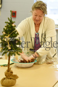 Harold Aughton/Butler Eagle: Joanie Lapic, a Therapeutic Horticultural Specialist at Glade Run Lutheran Services in Zelienople, mixes up a batch of dough for her class to make applesauce cinnamon and glue ornaments Wed., Dec. 4, 2019.