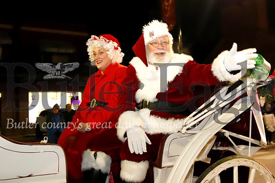 Santa waves to the crowd with Mrs. Claus Thursday during the Miracle on Main Street parade in Zelienople. Seb Foltz/Butler.