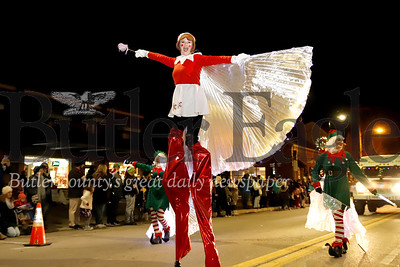 A Raggedy Anne clad Brittany Ball of Evolve Entertainment struts down Main Street in Zelienople during the town's Miracle on Main Street parade Thursday evening. Seb Foltz/Butler Eagle