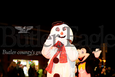Frosty the Snowman waves to the crowd during Zelienople's Miracle on Main Street parade and festival Thursday. Seb Foltz/Butler Eagle