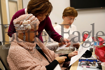 Terry Waite looks over makeup tips with Pat Julkowski of Creative Hair Solutions at AHN Cancer Institute's workshop Friday. Seb Foltz/Butler Eagle