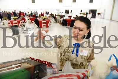 Harold Aughton/Butler Eagle: Chelynne Curci-Lang of Accurate Solutions Group drops of a bag of toys at the annual Butler Chamber of Commerce Holiday party.