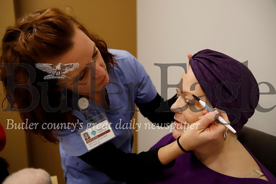 AHN Cancer Institute certified med asssistant and cosmotologist  Renee Swidzinski shows Kathi Elder of Butler a makeup technique at Friday's workshop for cancer patients. Seb Foltz/Butler Eagle