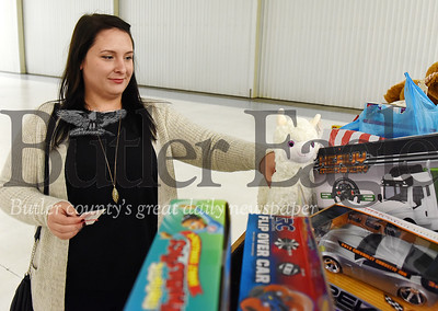 Harold Aughton/Butler Eagle: Merritt Rugg, a board member of the Butler Young Professionals, drops off a toy at the Butler Chamber of Commerce Holiday party, Friday, Dec. 6, 2019.