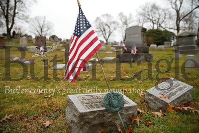 Already marked with flags, veteran graves at North Side Cemetery will soon be decorated with wreaths for the holidays. Seb Foltz/Butler Eagle