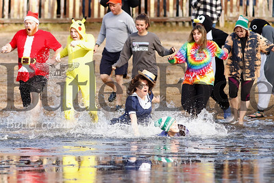 Bold plungers take a dip in the lower lake at Camp Lutherlynn Saturday morning for the organization's fourth annual Polar Plunge fund raiser. Volunteers had to break the ice on the lake with a kayak prior to the event. Participants raised over $13,000 for the camp's annual fund. Proceeds go to camper scholarships and other camp programs and maintenance. According to organizers, it was the first year the lake was ice covered. Seb Foltz/Butler Eagle