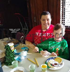 Drake Wilson, 9, and his mother, Jennifer Chacon, of Butler enjoy Breakfast with Santa Saturday, Dec. 7, 2019, at the Butler Township park building. The event was sponsored by the Butler County Parks and Recreation Department. Donna Sybert/ Butler Eagle