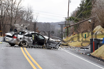 Harold Aughton/Butler Eagle: PSP investigate the scene of a one-car accident along route 38 Tuesday, Dec. 10, 2019.