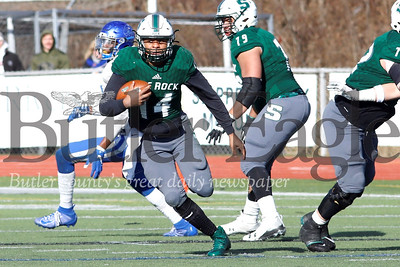 Slippery Rock quarterback Roland Rivers III tucks to run on a quarterback scramble in the first quarter of Saturday's 65-59 playoff win over Notre Dame Ohio. Seb Foltz/Butler Eagle