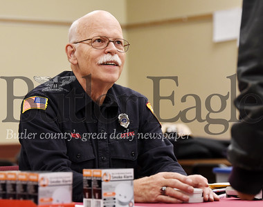 Harold Aughton/Butler Eagle: Cranberry Twp. Volunteer Fireman, Paul Brown, handed out fire detectors to seniors at the Muncipal Building, Wed., Dec. 11, 2019. The CTVF Company handed out free fire detectors to senior citizens of Cranberry Twp. at the Municipal Center. The department raised $3,000 to purchase 700 fire detectors at a discounted cost from Home Depot.
