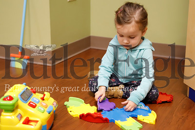 Sadie Harrington, 3, plays with a toy in Austin's Playroom at Butler Memorial Hospital Friday. The playroom, a program through the Mario Lemieux Foundation, is meant for kids to have a comfortable place to visit while visiting family in the hospital. Seb Foltz/Butler Eagle