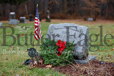 Veteran grave at at the St. John's United Methodist Church outside of West Sunbury.Volunteers and veterans were laying wreaths at a number of sites in the county as part of a National Wreaths Across America Day. Seb Foltz/Butler Eagle