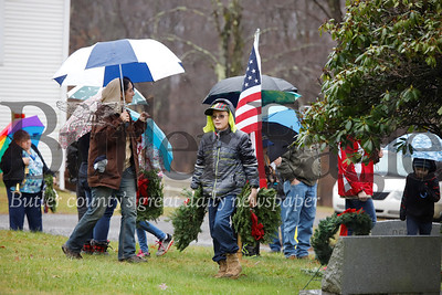 Noah Pallas, 11, of West Sunbury Boy Scout Troop 31 carries wreaths to the graves of veterans at the St. John's United Methodist Church outside of West Sunbury Saturday. The troop, volunteers and veterans were laying wreaths at a number of sites as part of a National Wreaths Across America Day. Seb Foltz/Butler Eagle