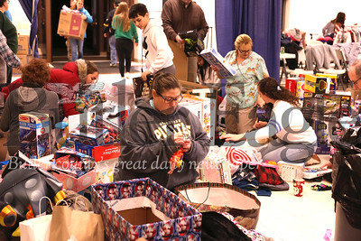 Volunteers sort through donated toys Friday night for Saturday's Lighthouse Foundation store for needy families. Seb Foltz/Butler Eagle