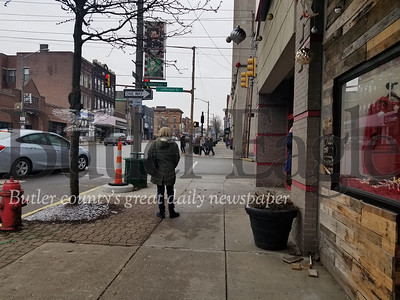 Employees from Hefren-Tillotsen headed to their cars at about 9:30 Monday morning after their building at the corner of Main and Jefferson streets closed due to a smell of natural gas.