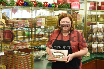 Harold Aughton/Butler Eagle: Lori Steinheiser displays the final product - a box of chocolates at Peter's Chocolates in Butler.