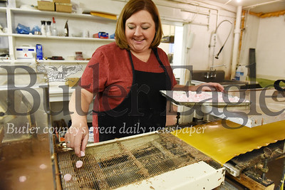 Harold Aughton/Butler Eagle: Lori Steinheiser places cherry filling on the conveyor belt.