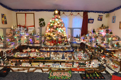 Harold Aughton/Butler Eagle: Robert Tirk of Parker Twp. has been collecting model trains for the past 44 years. Him and his wife started with two or three houses and one train set. Today, it takes about a month to setup the village, seven tracks for the more than 30 cars. They own two Lionel sets from the early 1950s.