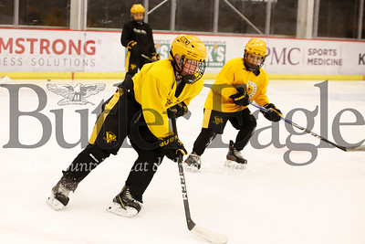 Roman Fluhme, 10, works the puck past Alex Sargo, 10, during EXCEL Hockey Academy practice at the UPMC Lemieux Sports Complex in Cranberry Tuesday. Seb Foltz/Butler Eagle