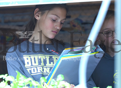 Malina McElory takes notes at the plant lab station in Butler Middle School's fisheries lab. Seb Foltz/Butler Eagle