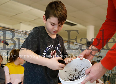 Fifth grader William Fielder scoops composting worms into a compost crate in Butler Middle School's Fisheries Program Nursery Wednesday. Seb Foltz/Butler Eagle