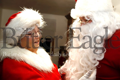 Becky Gitzen adjusts her son Glen's Santa beard prior to an appearance. Seb Foltz/Butler Eagle