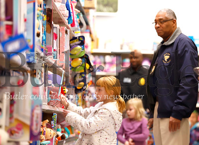 Kassidy Dunbar picks out a toy at Friday's Shop With a Cop at Walmart. Seb Foltz/Butler Eagle