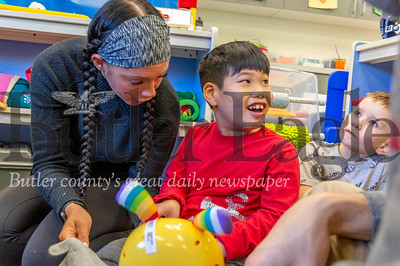 Madon Wannamaker, 5, of Cranberry Township smiles after playing with a toy at the Easterseals school Thursday. The toy was repaired by Duquesne University's START-Play Hackers. Alex J. Weidenhof/Butler Eagle.