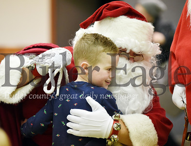 Harold Aughton/Butler Eagle: Carter Reinert, 5, of Prospect gives Santa a big hug at the Prospect Firehall, Monday, December 16, 2019.